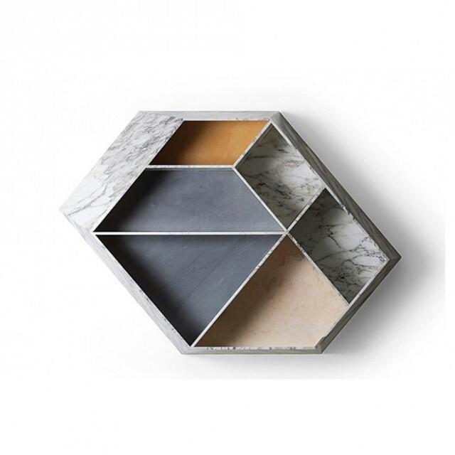 Decora__o_mineral_invade_a_casa__Garimpo_aposta_em_itens_com_textura_de_pedras._Veja_18_produtos_com_esta_tem_tica_hoje_em_casavogue.com.br._Na_foto__Estante_Earthquake_5.9__de_m_rmores_diversos__1_40_x_1_x_0_26_m__design_Patricia_Urquiola_para_Budri.jpg