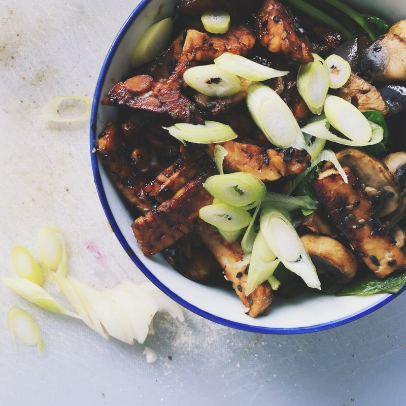 glazed tempeh with mushrooms and sauteed greens