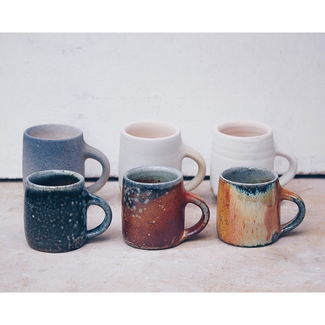 Three__espresso_cups__before_being_fired_and_after._A_red_shino_with_a_cobalt_and_black_stain_sprayed_on__a_tan_slip_and_a_yellow_glaze._Such_a_drastic_difference_between_the_two_but_an_interesting_comparison_nonetheless._These_are_the_three_glazes_w.jpg