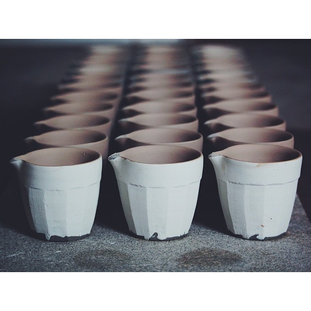 A_board_of_faceted_creamers__in_their_soft__post_slipped_state._When_I_pour_the_slip_inside_I_ll_pour_it_out_via_the_spout__to_stop_it_gathering_on_the_lip_I_ll_give_it_a_gentle_flick_to_wipe_away_the_excess__meaning_I_ll_keep_the_nice_sharp_edge_tha.jpg