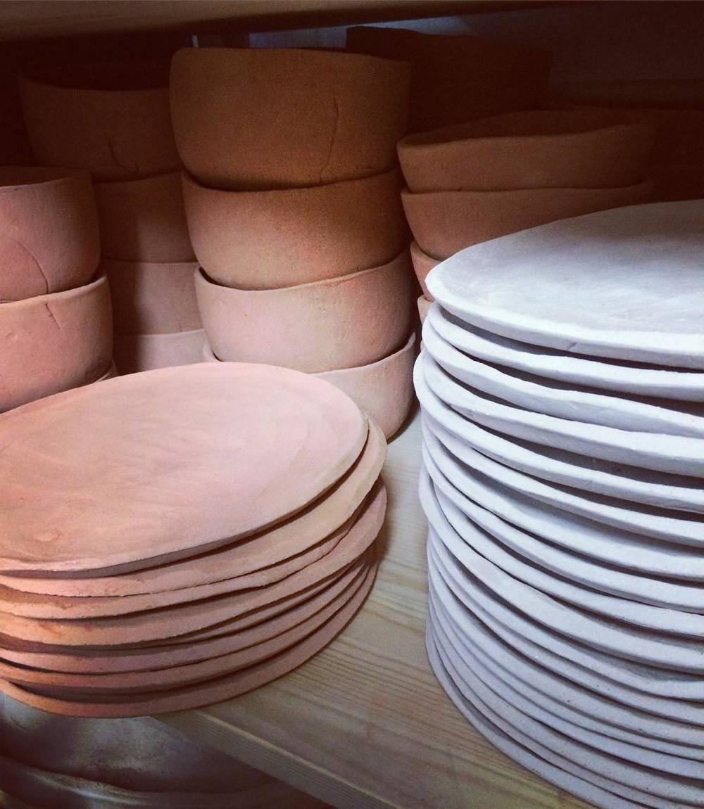 Stacks_of_bisque_fired_plates_and_bowls_from_Kana_new_collection_ready_to_be_glazed_and_fired_-_what_gonna_be_the_colour___kanabasic__kanashop__kanalondon__comingsoon__newcollection__new__workinprogress__studiolife__studiomoments__studio__kanaceramic.jpg