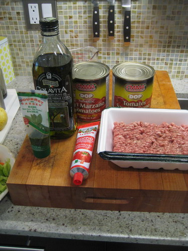 TWO CANS SAN MARZANO TOMATOES, BASIL, TOMATO PASTE, 500 gms GROUND LAMB. OLIVE OIL