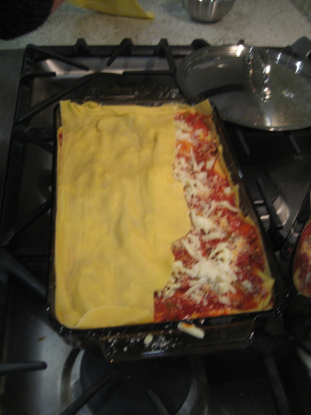 COVER BASE TOMATO LAYER WITH PASTA SHEET(S) AND ADD SAUCE, MOZZARELLA,  Béchamel OR  RICOTTA, GRATED PARMESEAN & REPEAT