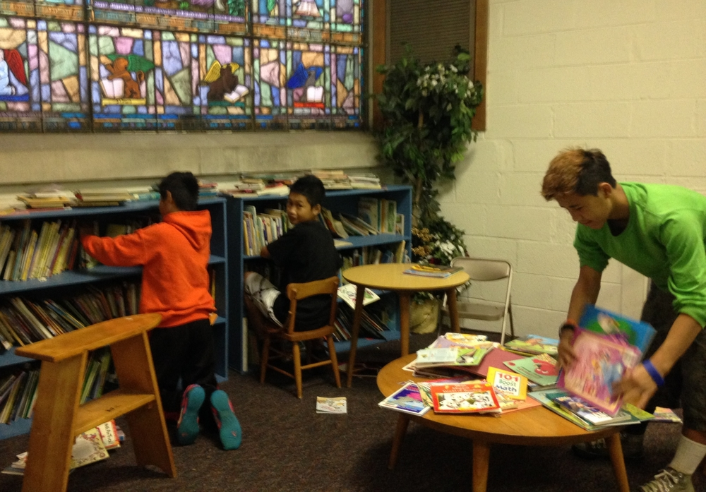 Northlake Teens straighten up the library at St. Paul's Episcopal Church