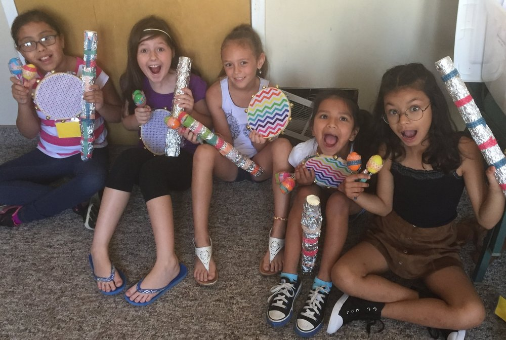 A few of the Art  Camp participants showing off the instruments that they made.