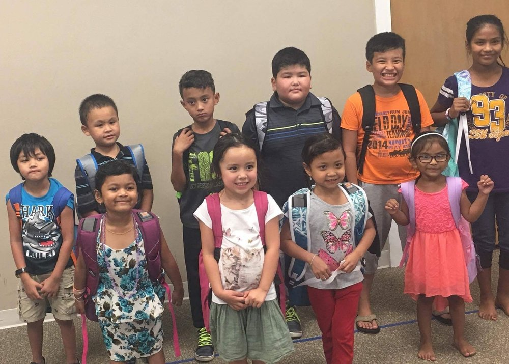 Refugee Kids Club students received backpacks before they went back to school.