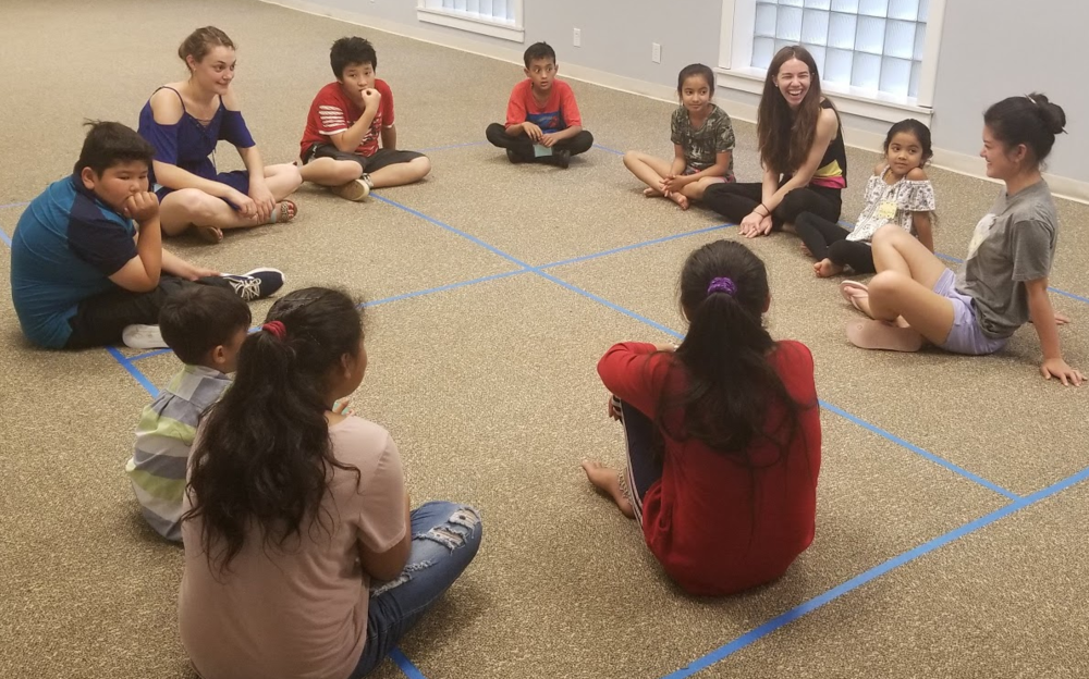 Laxmi shares her faith with the kids from Refugee Kids Club