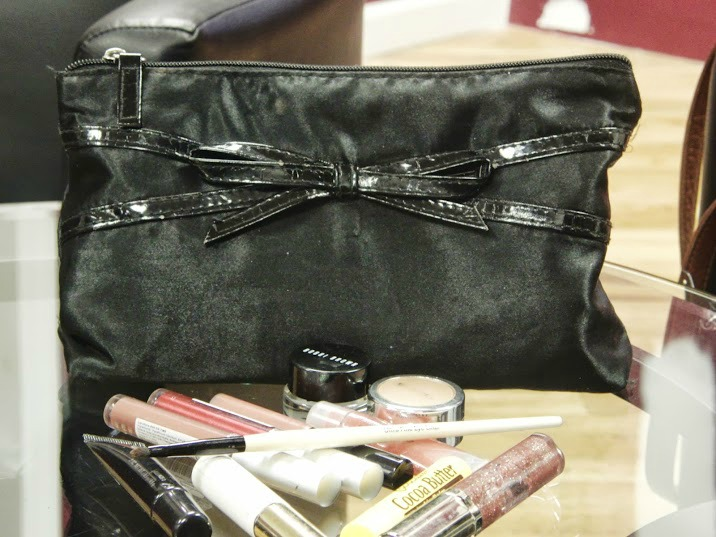 Kara's Makeup bag- Contained the basics lip gloss, concealer, a gold eyeshadow and gel eyeliner.