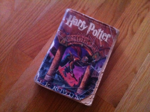 My poor, taped-up copy of Harry Potter and the Sorcerer's Stone went with me to all places, including to Europe.