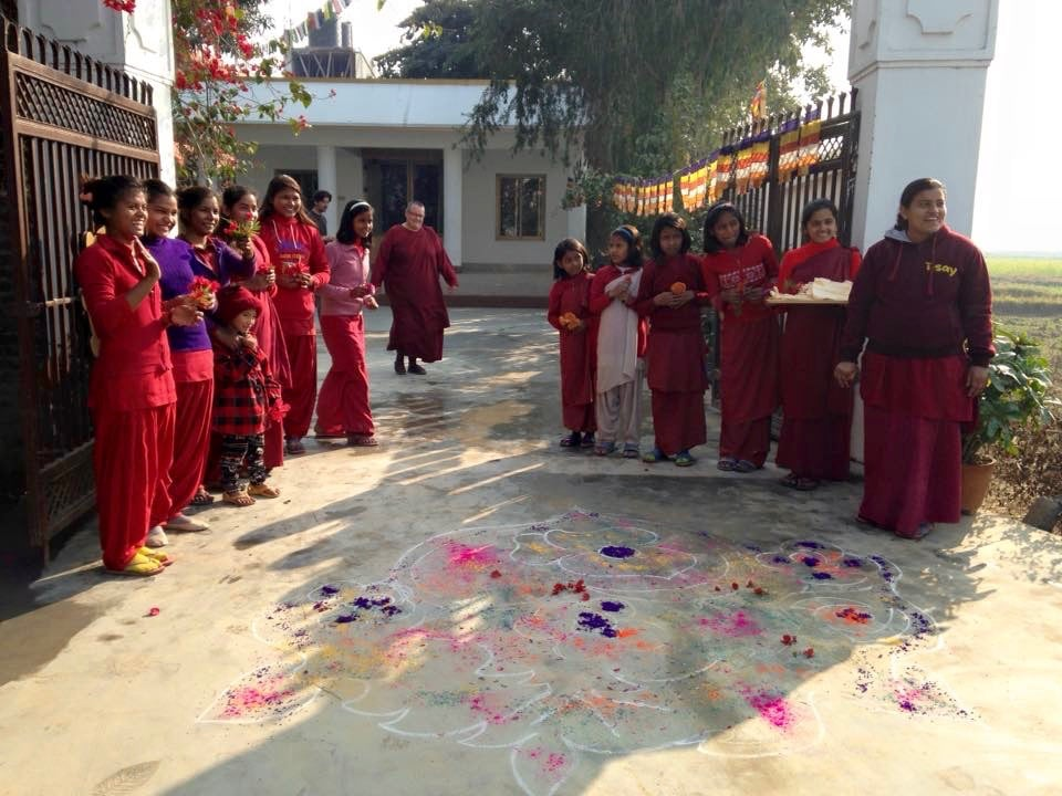 Bodhi and The Karuna School girls welcome us