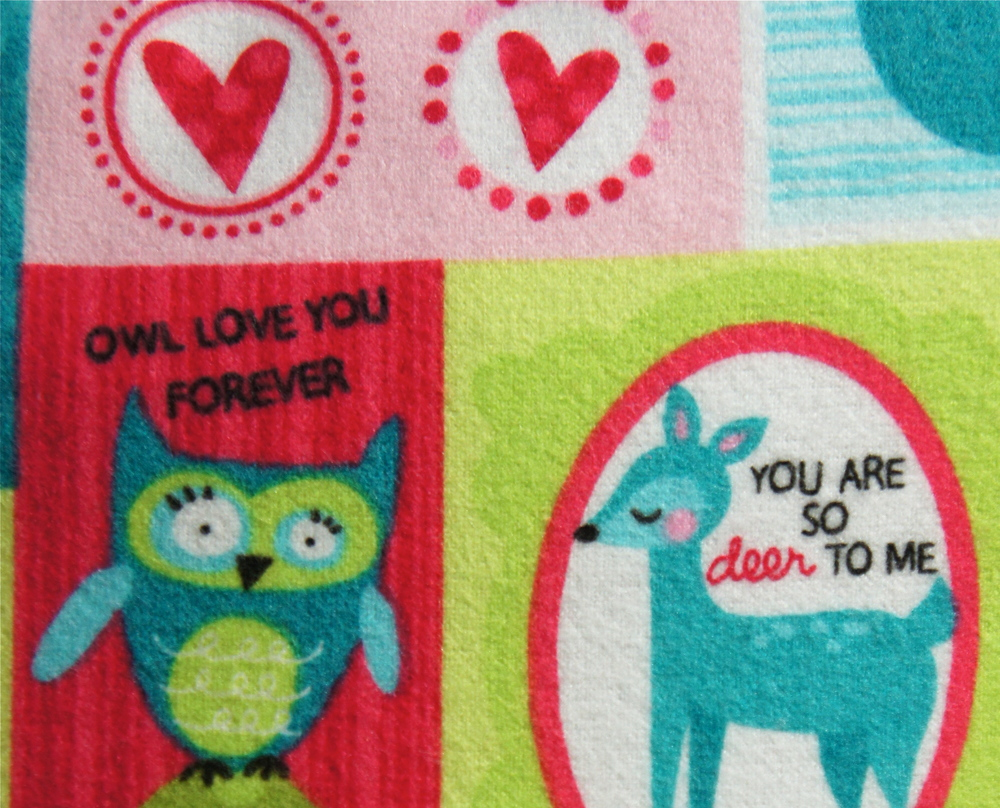 This awesome fabric inspires the feelings of love and warmth with whimsical illustrations and messages.