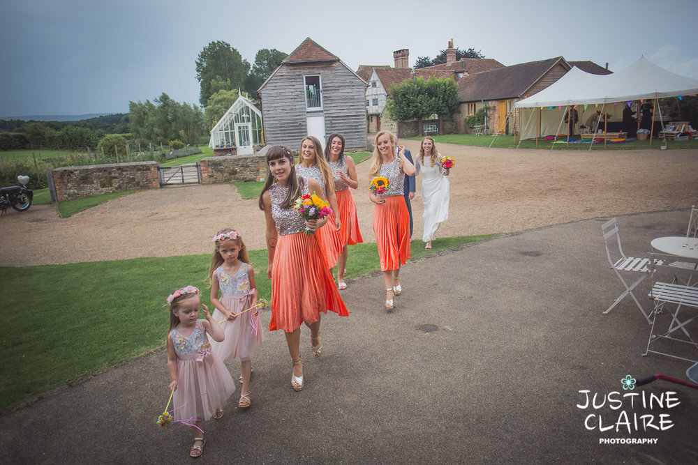 Bright vibrant stunning wedding  Grittenham Barn wedding venue sussex pretty barn wedding photographers and photography to capture your day - Justine Claire Photography #grittenhambarn #grittenhambarnphotographers #bestbarnphotographerssussex #sunflowers