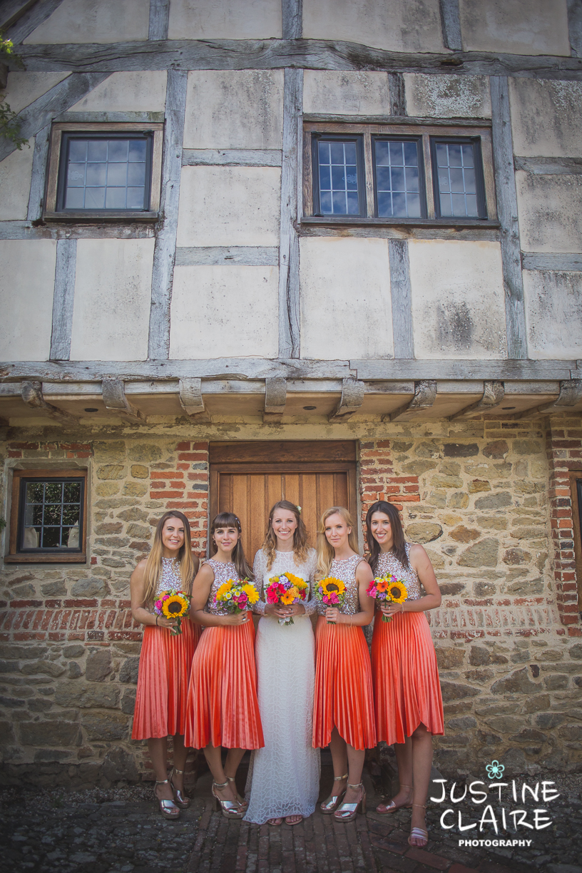 Barn wedding Bridesmaids in Orange skirts