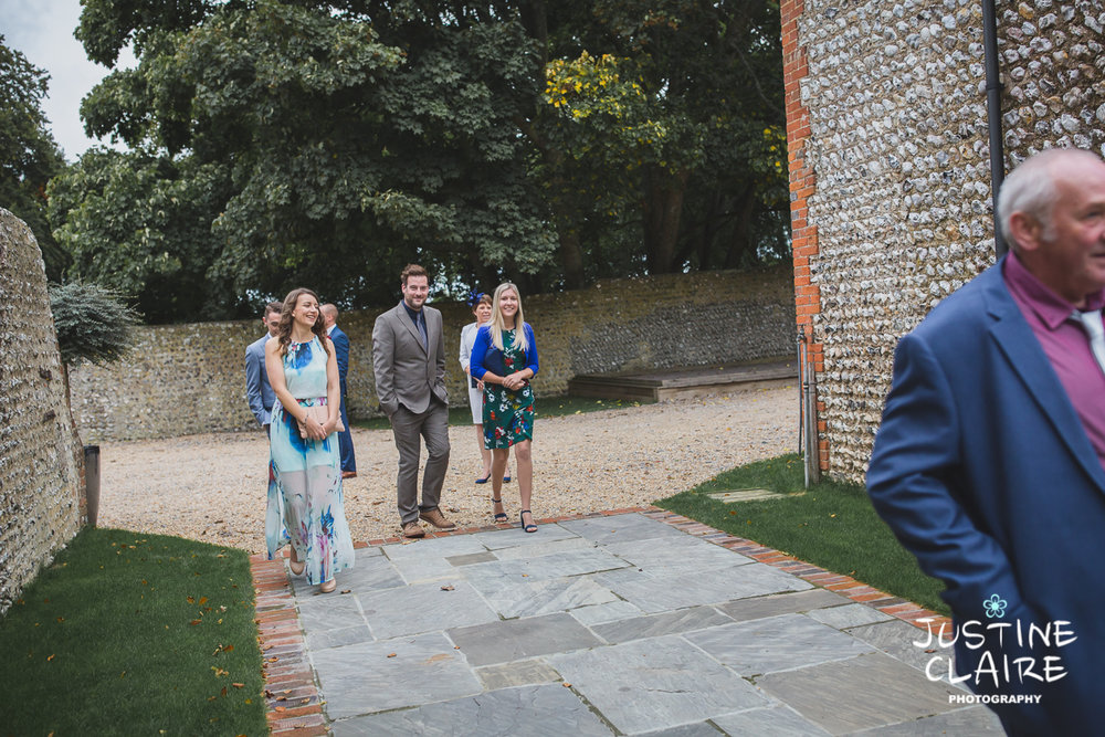 wedding photographer at Cissbury barn Findon Barn Venue Sussex reportage-5.jpg