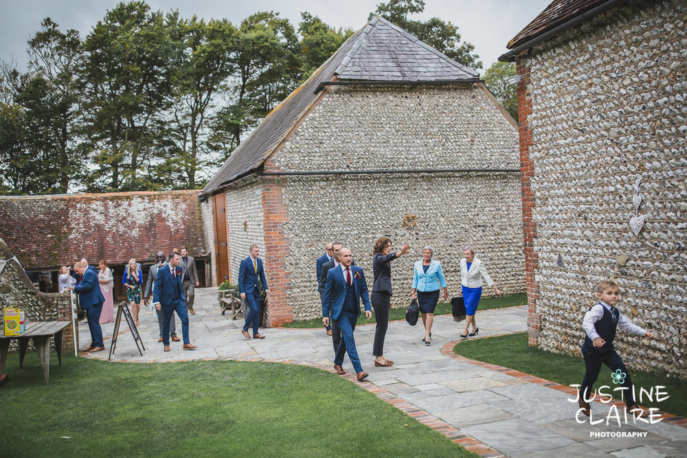wedding photographer at Cissbury barn Findon Barn Venue Sussex reportage-11.jpg