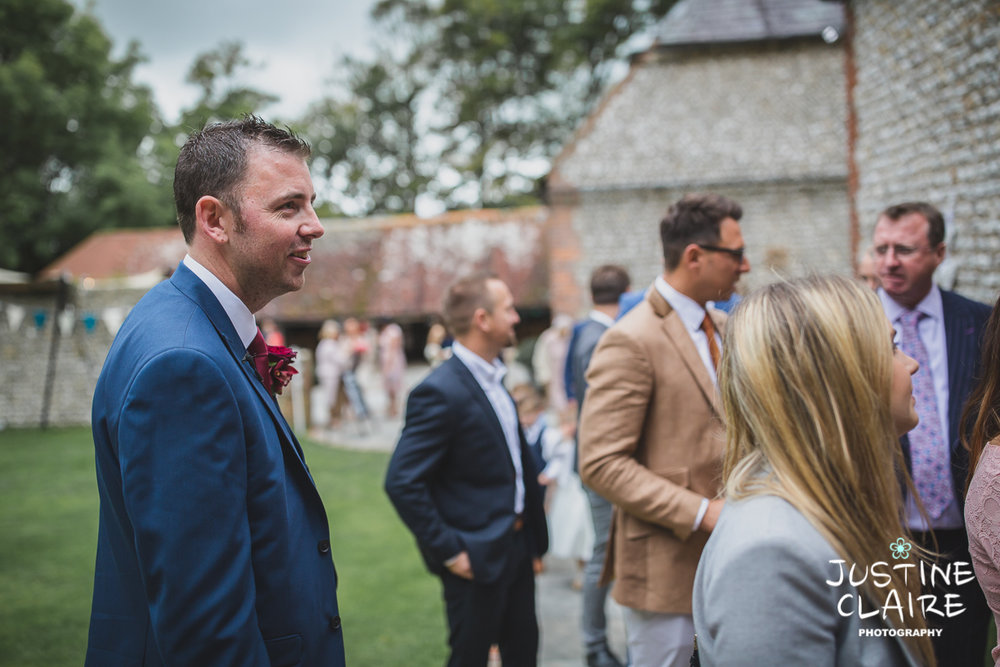 wedding photographer at Cissbury barn Findon Barn Venue Sussex reportage-13.jpg