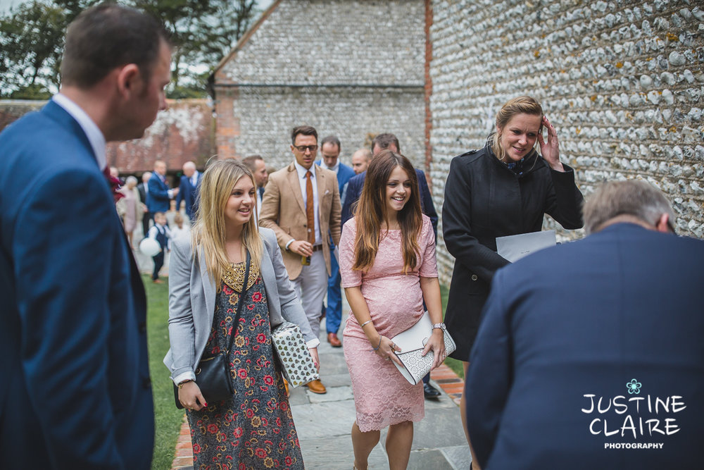 wedding photographer at Cissbury barn Findon Barn Venue Sussex reportage-12.jpg
