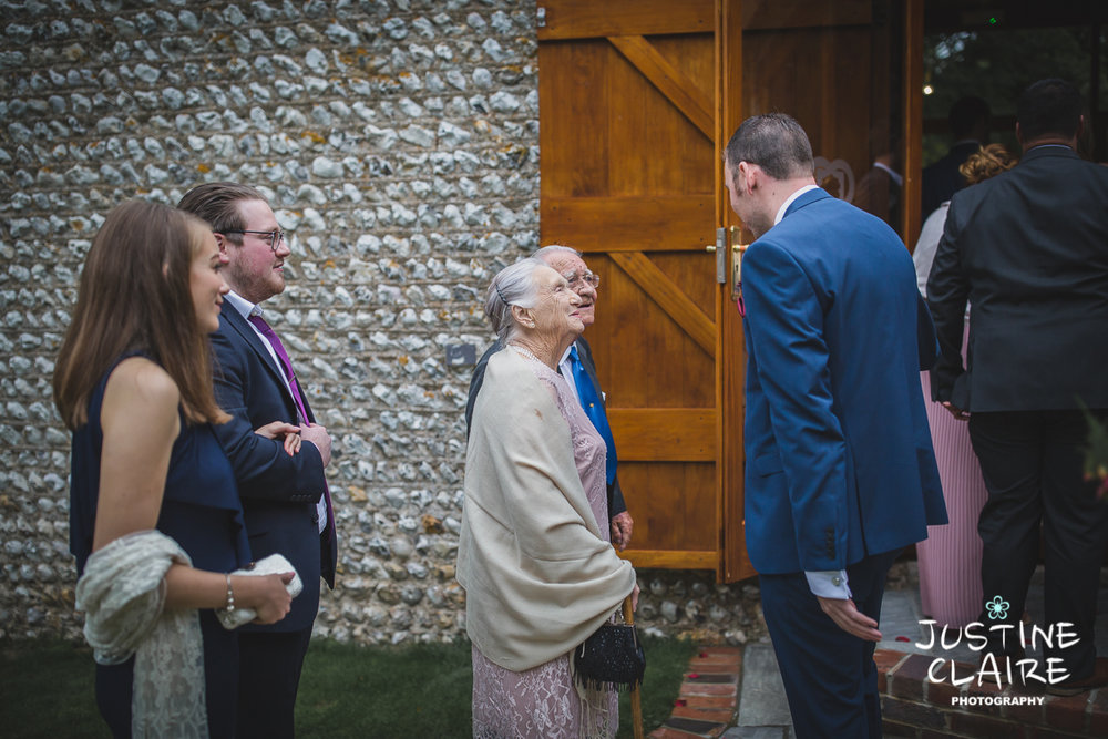 wedding photographer at Cissbury barn Findon Barn Venue Sussex reportage-14.jpg