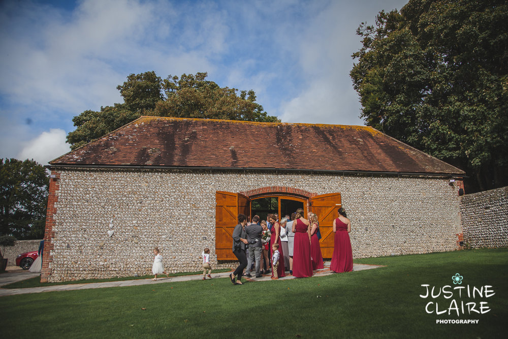wedding photographer at Cissbury barn Findon Barn Venue Sussex reportage-34.jpg