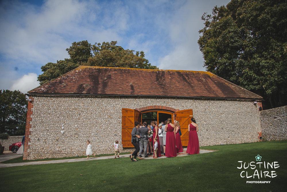 wedding photographer at Cissbury barn Findon Barn Venue Sussex reportage-34.jpg