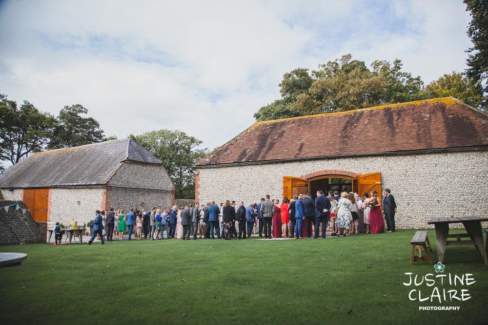 wedding photographer at Cissbury barn Findon Barn Venue Sussex reportage-44.jpg