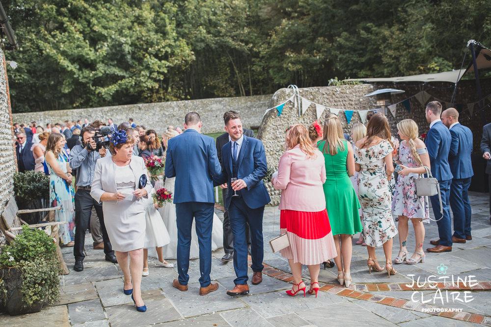 wedding photographer at Cissbury barn Findon Barn Venue Sussex reportage-45.jpg