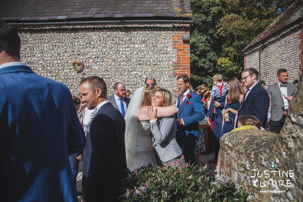 wedding photographer at Cissbury barn Findon Barn Venue Sussex reportage-46.jpg
