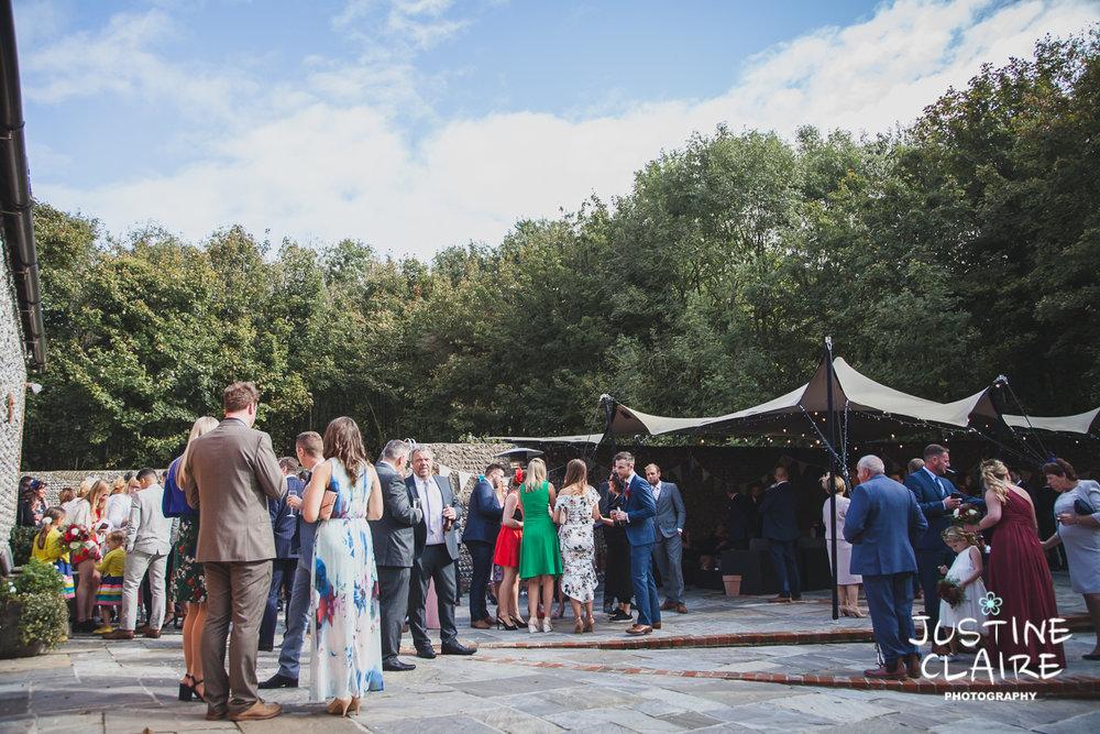 wedding photographer at Cissbury barn Findon Barn Venue Sussex reportage-47.jpg