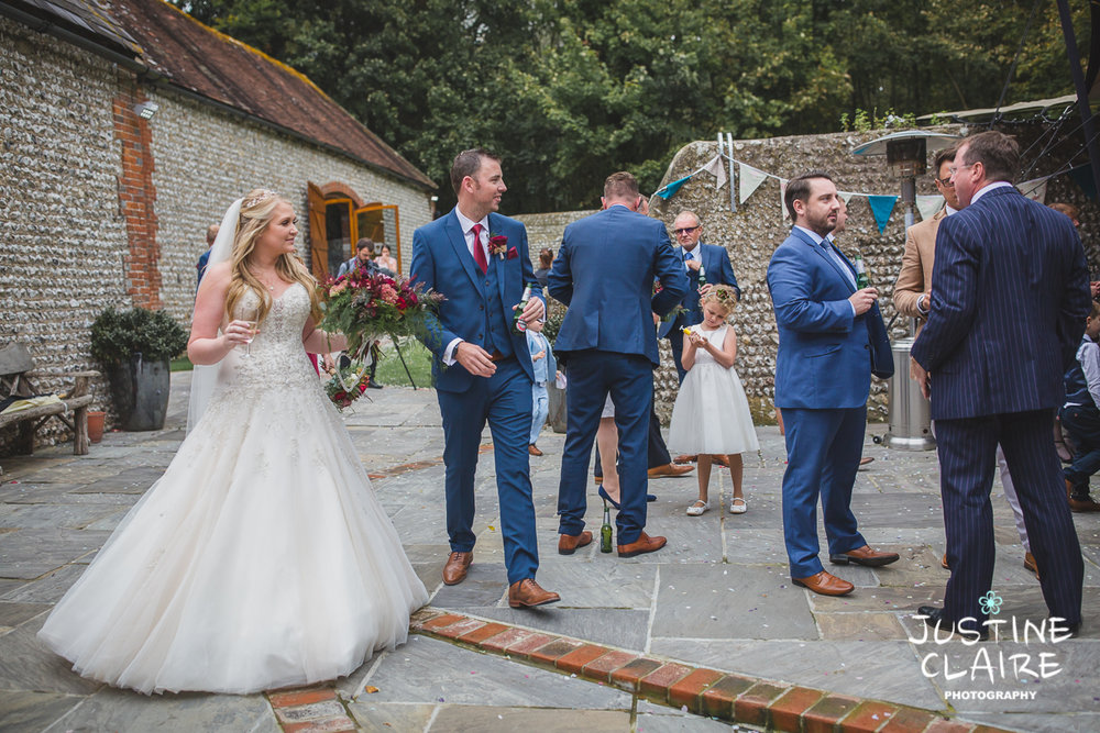 wedding photographer at Cissbury barn Findon Barn Venue Sussex reportage-61.jpg