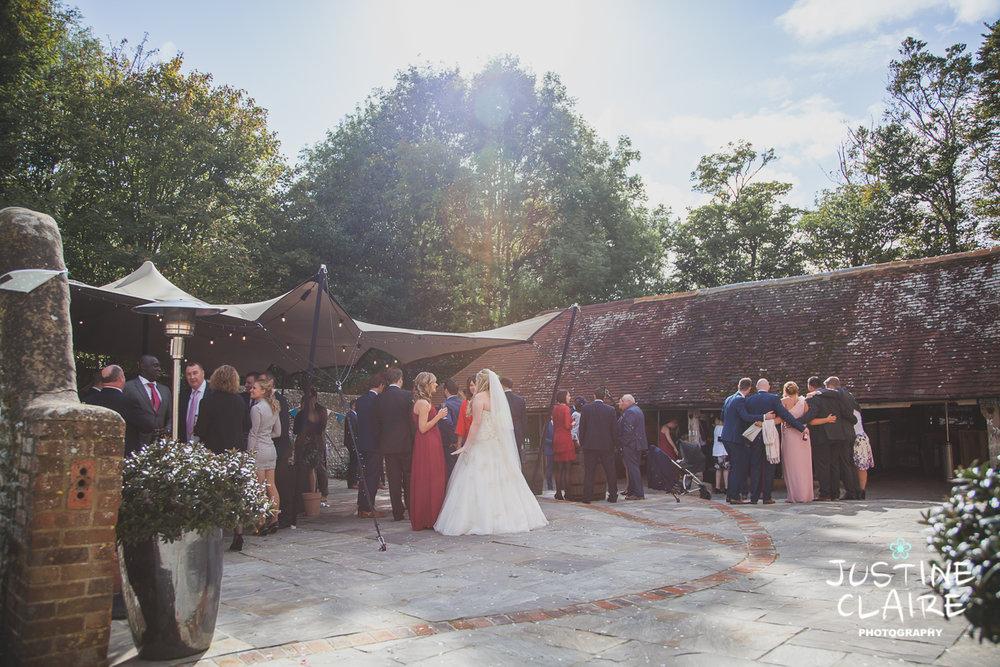 wedding photographer at Cissbury barn Findon Barn Venue Sussex reportage-69.jpg