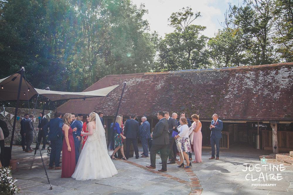 wedding photographer at Cissbury barn Findon Barn Venue Sussex reportage-71.jpg