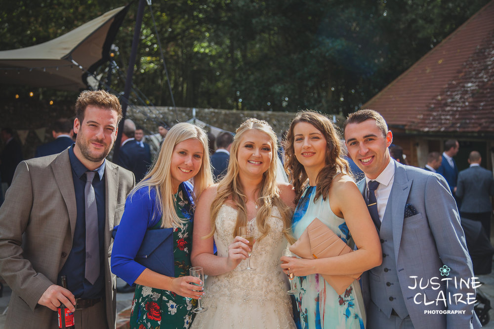 wedding photographer at Cissbury barn Findon Barn Venue Sussex reportage-75.jpg