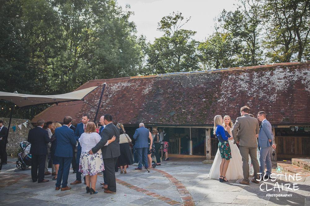 wedding photographer at Cissbury barn Findon Barn Venue Sussex reportage-74.jpg