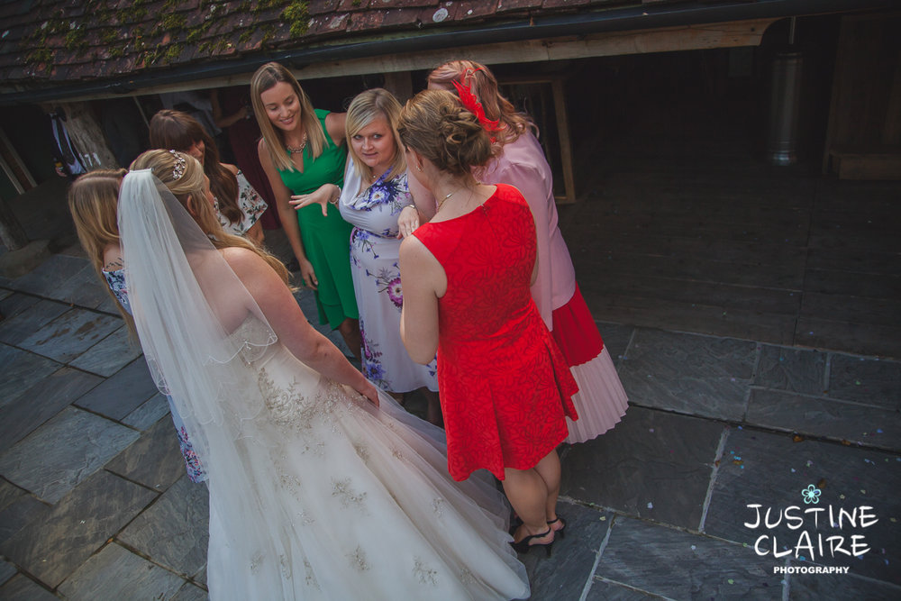 wedding photographer at Cissbury barn Findon Barn Venue Sussex reportage-82.jpg