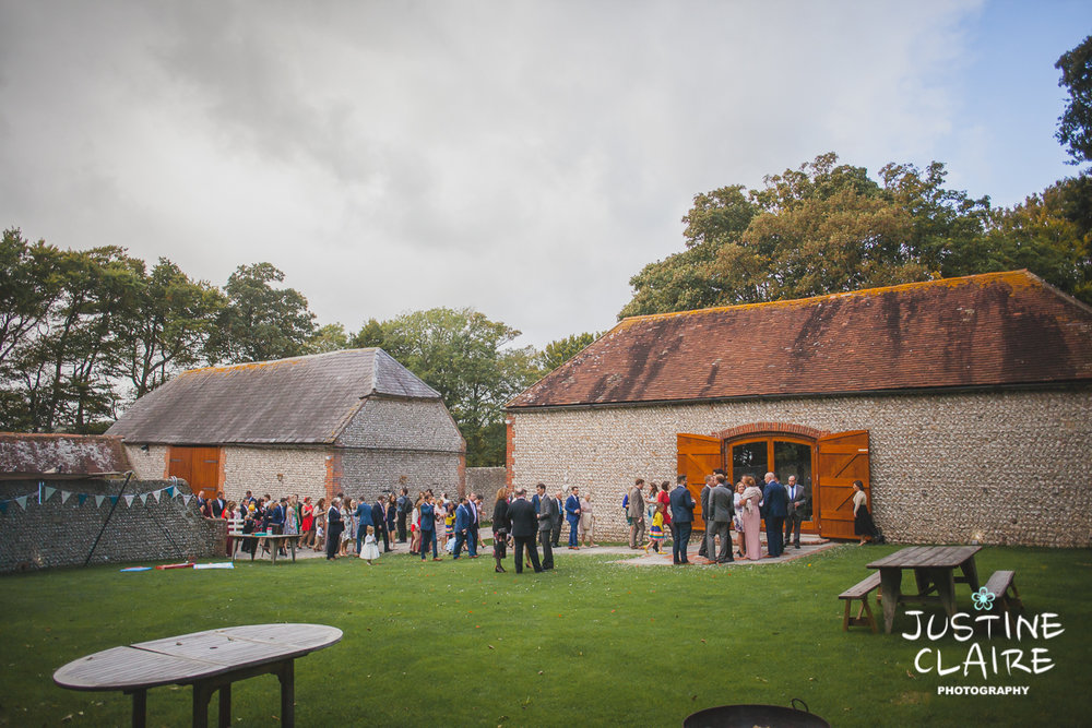 wedding photographer at Cissbury barn Findon Barn Venue Sussex reportage-84.jpg
