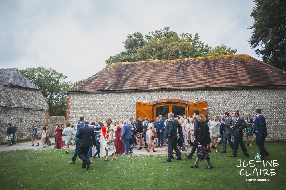 wedding photographer at Cissbury barn Findon Barn Venue Sussex reportage-95.jpg