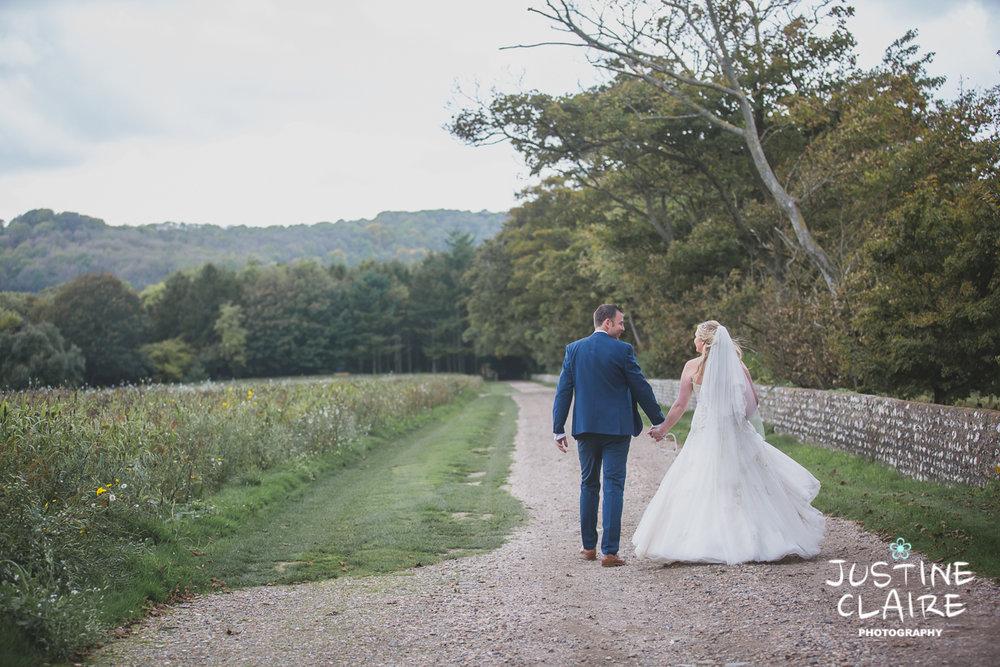 wedding photographer at Cissbury barn Findon Barn Venue Sussex reportage-100.jpg