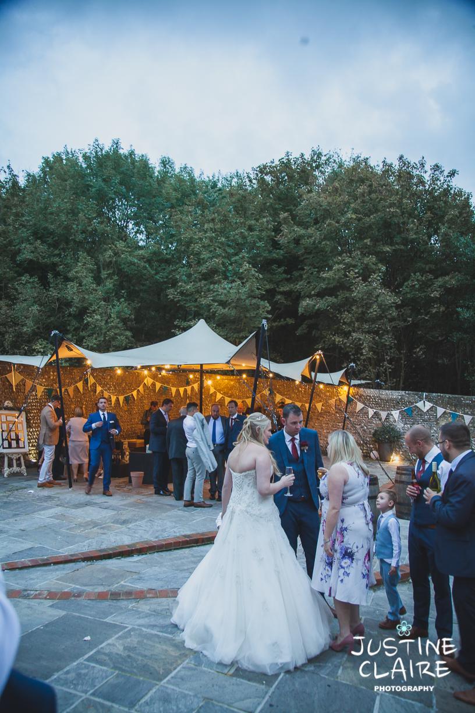 wedding photographer at Cissbury barn Findon Barn Venue Sussex reportage-126.jpg