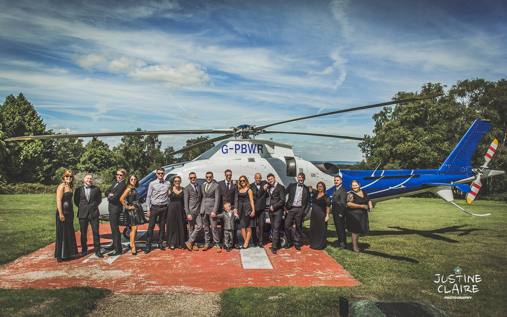west sussex wedding photographer Helicopter arrival at wedding sussex Alexander House wedding-27.jpg