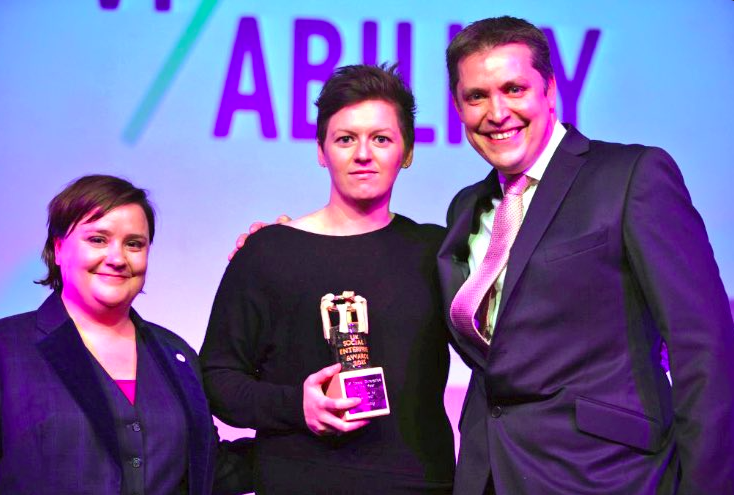 Founder & CEO Kelly Davies receiving UK's Best Social Enterprise award 2015