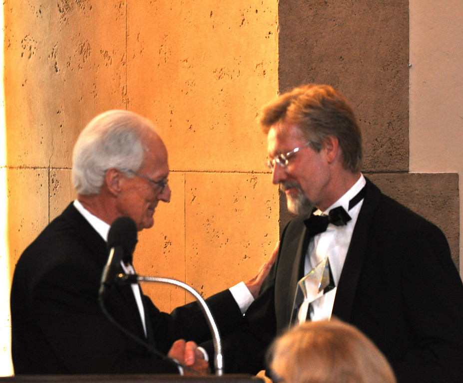2012 inductee Chris Bangle (former chief of design, BMW) receives his award from 2006 inductee Jack Telnack (Don Wood III).