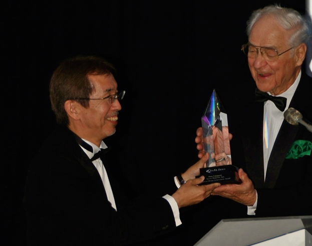 2010 inductee Shiro Nakamura (left, SVP and chief creative officer, Nissan Motor Company) is presented his award by Dr. Philip Hessburg.