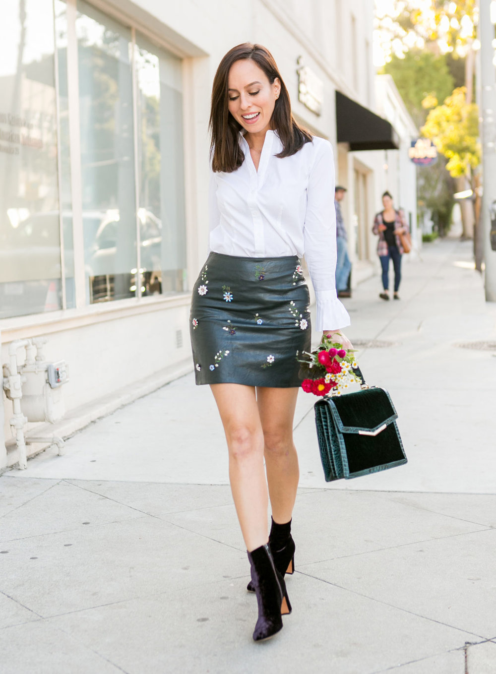 Sydne-Style-shows-how-to-wear-a-leather-mini-skirt-and-booties-for-fall-1200x1631.jpg
