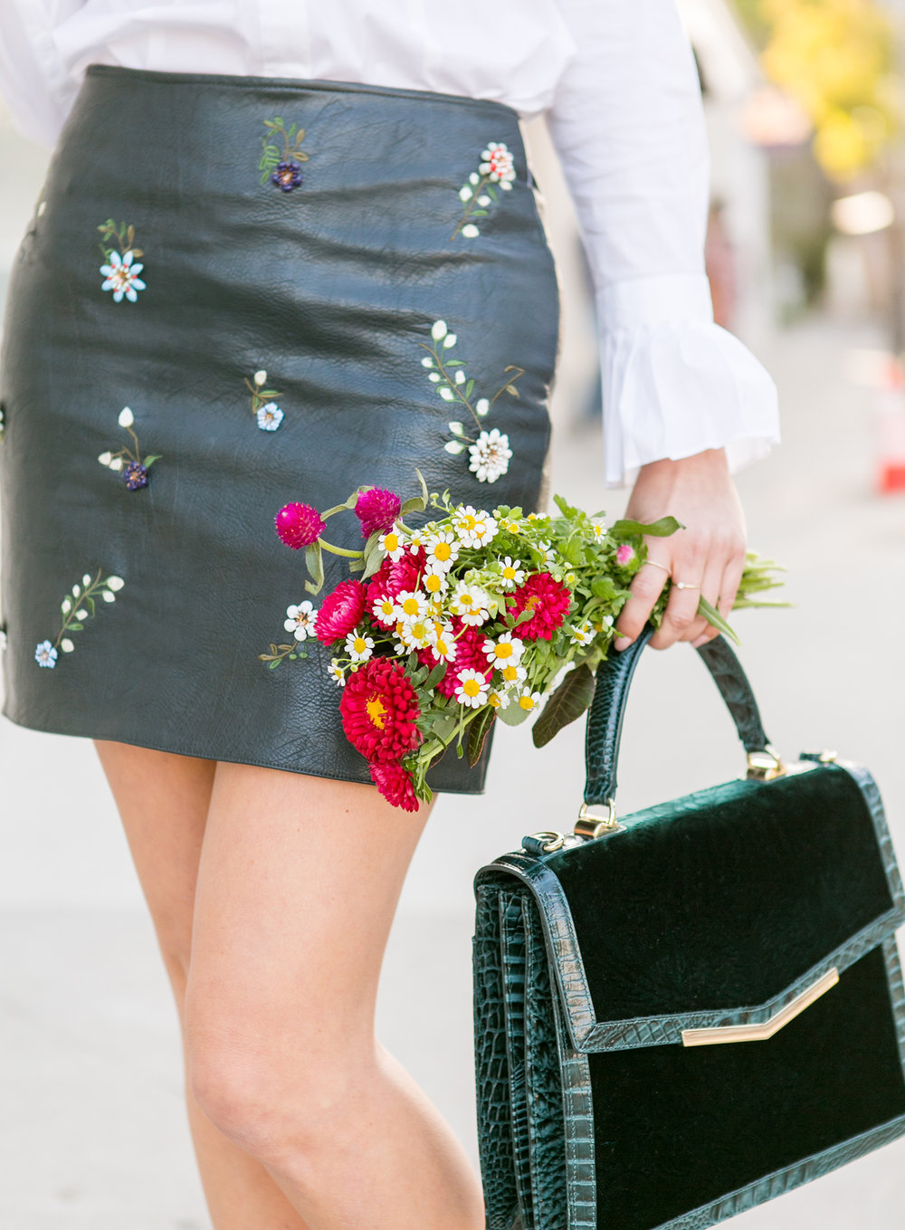 Sydne-Style-shows-how-to-wear-a-mini-skirt-for-fall-in-green-leather.jpg