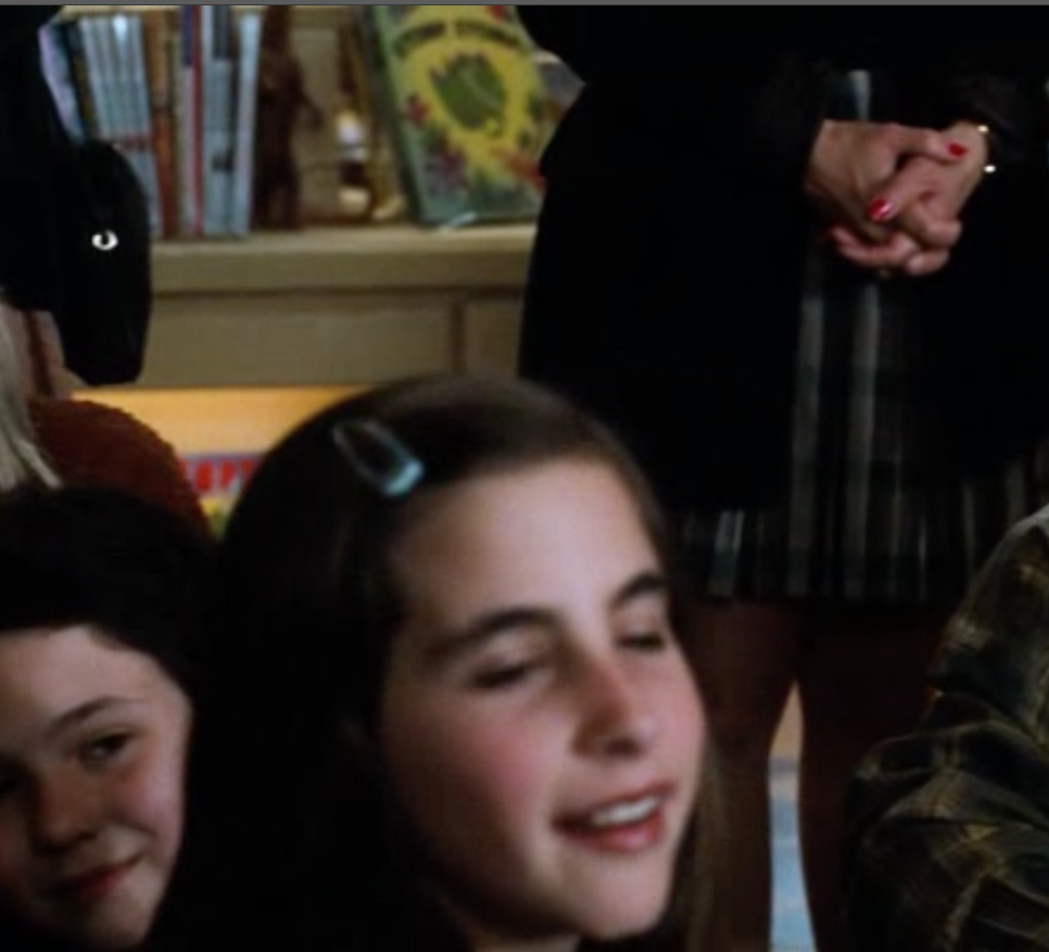 This is a screen cap from the movie You've Got Mail.  It's a scene from the story hour at Meg Ryan's book shop.  And yes, that's my first book Stomp Stomp on the shelf in the background.
