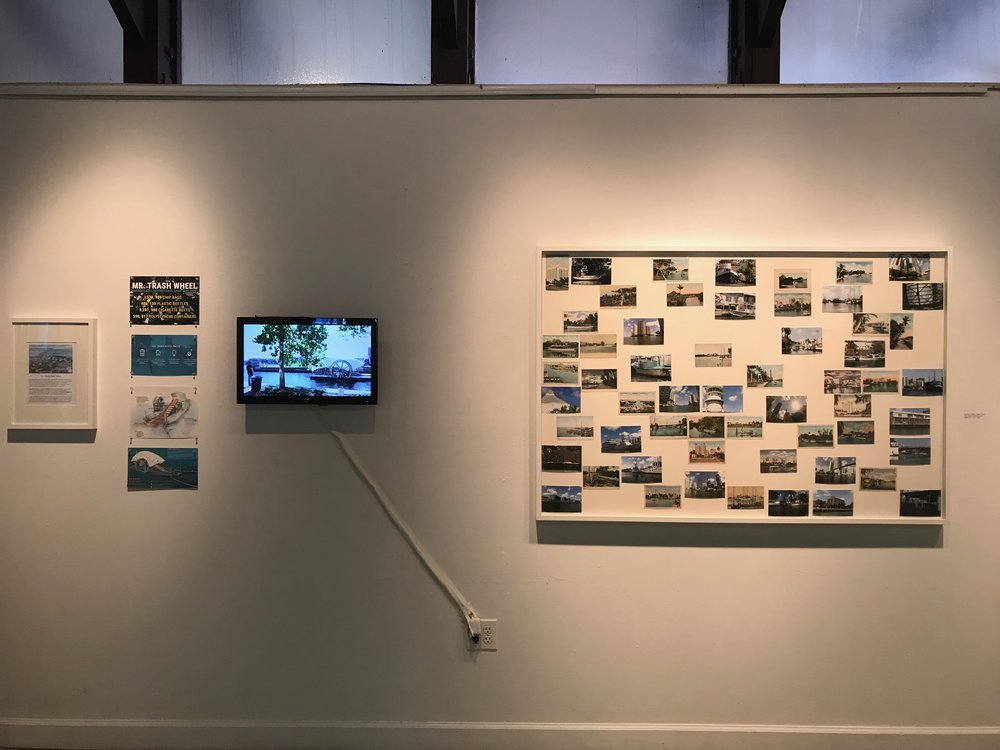 """From left to right: Miami River Show , Gustavo Oviedo     """"Mr.Trash Wheel""""  Project  4 videos compilation  Gustavo Oviedo   """"Miami River"""" , 2016  eBay items and photo prints (detail)  61"""" x 41"""