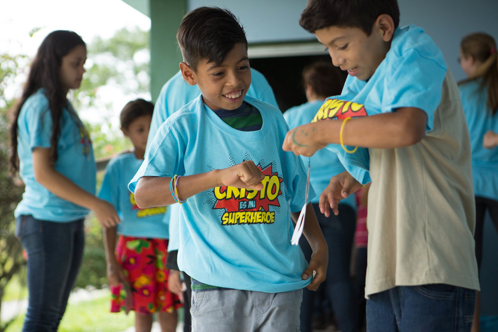 The kids loved the shirts. They all had smiles on their faces as the VBS volunteers helped put them on.