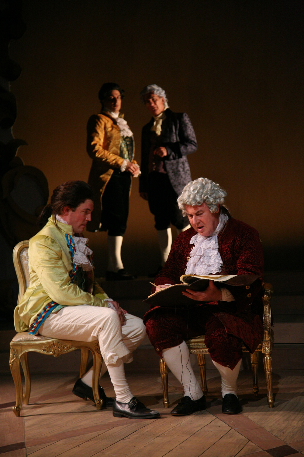 Amadeus - Mozart (Jordan Coughtry), Count Orsini-Rosenberg (Colin McPhillamy). Background -  Salieri (Robert Cuccioli), Von Strack (John Little).JPG