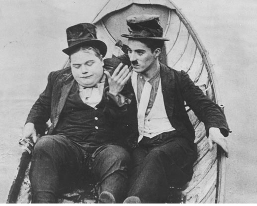 "Roscoe ""Fatty"" Arbuckle and Charlie Chaplin in  THE ROUNDERS  (1914)"