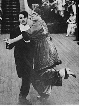 Charlie Chaplin and Marie Dressler in   TILLIE'S PUNCTURED ROMANCE  (1914)
